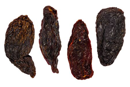 Composite of four dried Morita chile peppers on a white background.