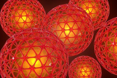 3D render of several red lattice spheres against a dark background. Each sphere has a golden glow in the center.