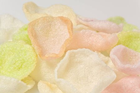 Background texture of several shrimp chips, also known as prawn crackers.