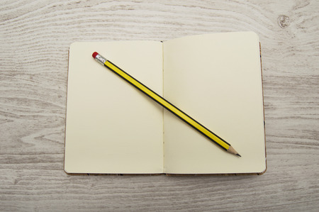 write off: Note book with pencil on wooden table