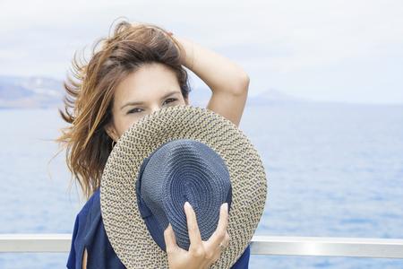 The woman hides behind her hat. Banco de Imagens