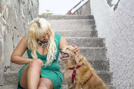 sweetie: She caresses her dog