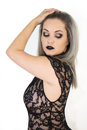 Isolated sexy woman, with lace lingerie and black makeup Foto de archivo - 98831586