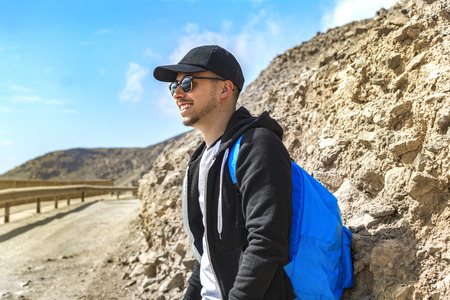 Young backpacker on his adventure to travel the world. Stock Photo