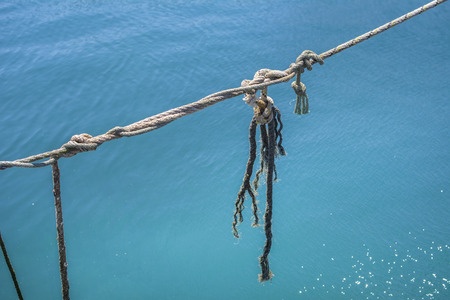 Mooring rope over the blue sea.