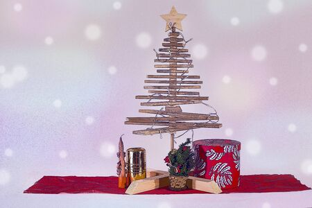 Christmas postcard, with a wooden Christmas tree, colored lights and gifts.