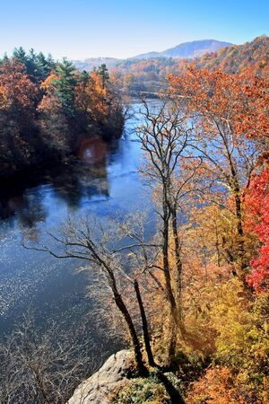 View of French Broad River and distant mountains in autumn on Blue Ridge Parkway, North Carolina photo