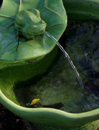 garden fountain: Garden frog fountain Stock Photo