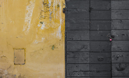 scraped: Scraped wall and a wooden door Stock Photo