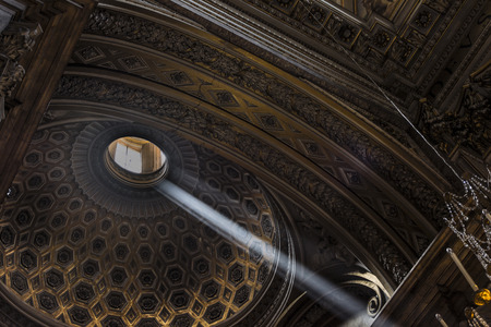 a ray of sunlight in a dark church photo