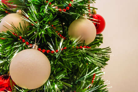 plastic christmas tree: Close up of a decorated christmas tree with white and red balls Stock Photo