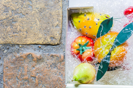 reproducing: Typical sicilian candies made with almonds reproducing fruits and vegetables in a white box