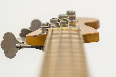 close up of the head of an electric four sting bass Stock Photo