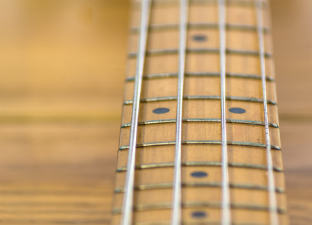 g string: fretboard of a four strings electric bass