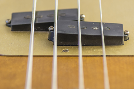 g string: close up of pickips ofa a four strings electric bass Stock Photo