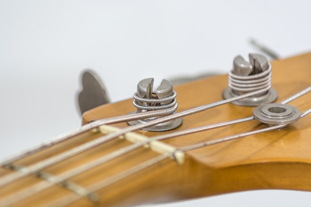 the head of an electric bass with details of the sprocket, the string guide, Stock Photo