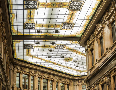 glass ceiling: the decorated glass ceiling of Galleria Alberto Sordi in Rome finished building in 1922 Editorial