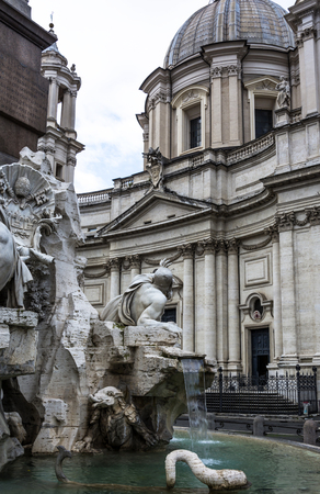 cowering: The legend is that Bernini positioned the cowering Rio de la Plata River as if the sculpture was fearing the facade of the church of SantAgnese by his rival Borromini could crumble against him; in fact, the fountain was completed several years before Bor