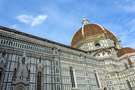begun: Il Duomo di Firenze, as it is ordinarily called, was begun in 1296 in the Gothic style with the design of Arnolfo di Cambio and completed structurally in 1436 with the dome engineered by Filippo Brunelleschi