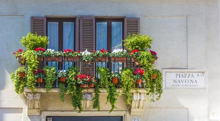 navona: balcony with flowers in piazza navona, rome