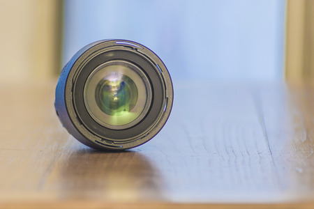 photo lens on a wood plain Stock Photo