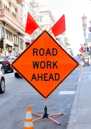 orange sign: Road work ahead orange sign on the street