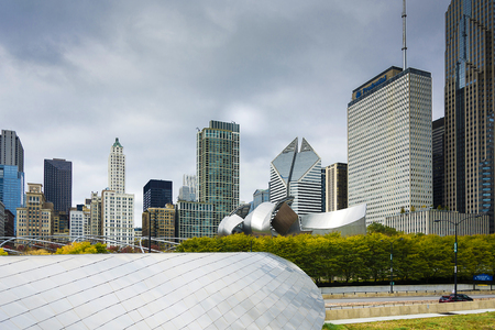 Chicago, IL, USA, october 27, 2016: The BP Bridge in Millennium Park, Chicago, Illinois, USA Chicago skyline in the background sunny winter day
