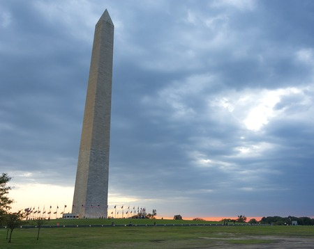 washington monument: Washington Monument at sunset with heavy clouds Stock Photo