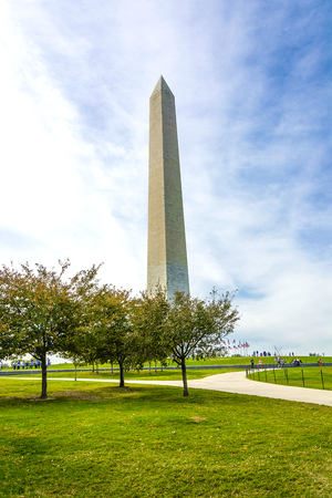 George Washington monument through green trees, Washington DC, USA Stock Photo