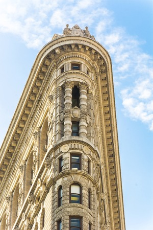 New York, USA, November 2016: Flat Iron building facade from Broadway in Manhattan, New York City. The Flat Iron building, a groundbreaking architectural feat was completed in 1902.
