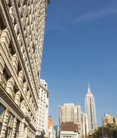 fifth avenue: New York, USA, november 2016: the Empire state building viewed from Broadway at Flat Iron building feet Editorial