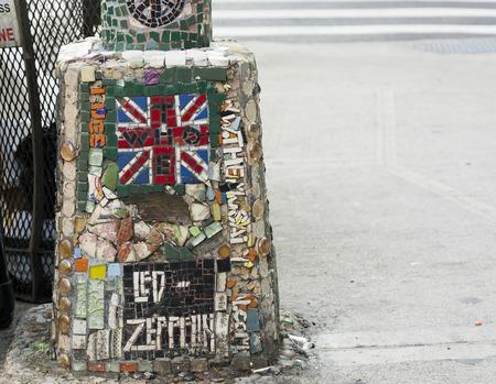 New York, USA, november 2016: detail of a Jim Power mosaic on a street pole