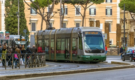 tramway: Rome, Italy, february 2017: Line 8 Tram moving in Largo Argentina in Rome, Italy. Line 8 was opened in 1998 and connects Piazza Venezia to the Casaletto Neighborhood