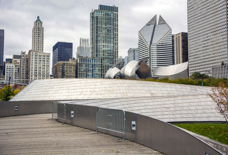 Chicago, IL, USA, october 27, 2016: The BP Bridge in Millennium Park, Chicago, Illinois, USA Chicago skyline in the background cloudy day