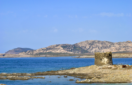 Amazing view of the famous La Pelosa Beach with the landmark 16th century Watchtower (Torre della Pelosa) Stock Photo
