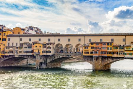 river arno: Famous bridge Ponte Vecchio (Old Bridge, 1218, 1345) - arch bridge over the Arno River in Florence, Tuscany, Italy