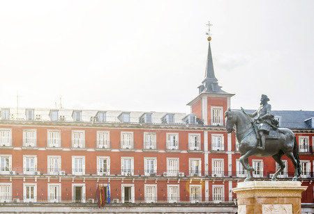 the equestrian bronze statue of king Philip lll in Plaza Mayor in Madrid, Spain Editorial