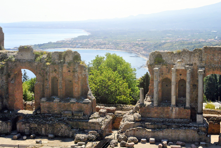 the Ancient Theatre of Taormina with Etna Mountain and mediterranean sea in background in Sicily, Italy