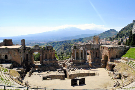 the Ancient Theatre of Taormina with Etna Mountain in background in Sicily, Italy Stock Photo