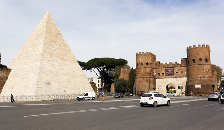 Rome, Italy, march 24, 2017: Pyramid of Caius Cestius and San Paolo Gate in Rome, Italy