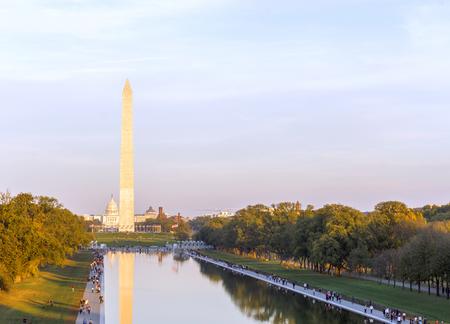 Washington Monument and Reflecting Pool at sunset in autumn, Washington DC, USA