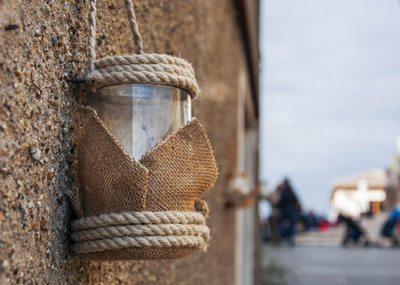 Vintage Candle glass lantern with rope hanging outdoor Stock Photo