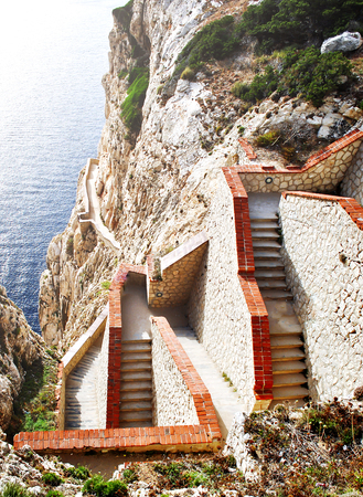 steep staircase built on a mountain overlooking the sea in Sardinia, Italy Stock Photo