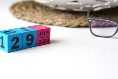 modern perpetual calendar composed of colored cubes and set at the date of June 29