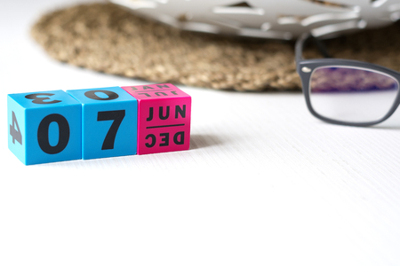 modern perpetual calendar composed of colored cubes and set at the date of June 7
