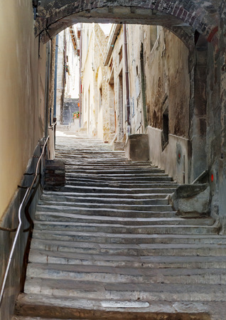 Ancient Staircase With An Arch In The Center Of Cortona In Tuscany, Italy  Stock Photo