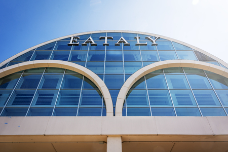 Rome, Italy, April 2017: bottom view of the exterior glass facade of the famous Italian food store Eataly in Rome