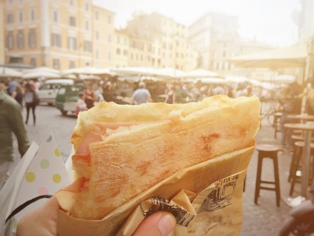 Street food in Rome is focaccia stuffed with mortadella Stock Photo - 104860001