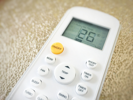 Display of an air conditioner remote control with temperature set at 26 degrees 免版税图像