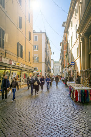 Rome, Italy, December 21st, 2014: People and tourists walking along the ancient Via dei Baullari in Rome, Italy
